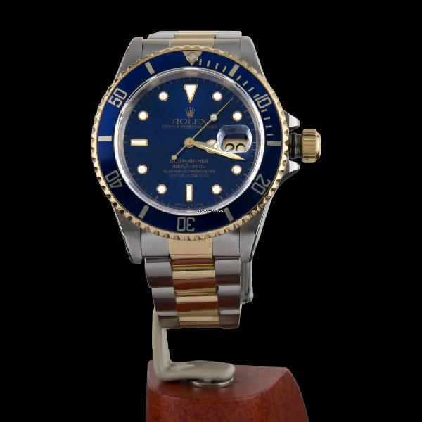 Rolex oyster perpetual date submariner steel and gold 300m