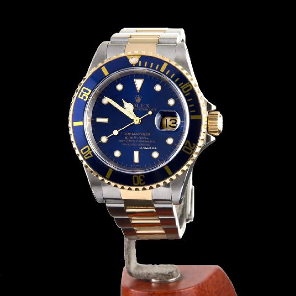 Rolex oyster perpetual submariner date steel and gold 300m