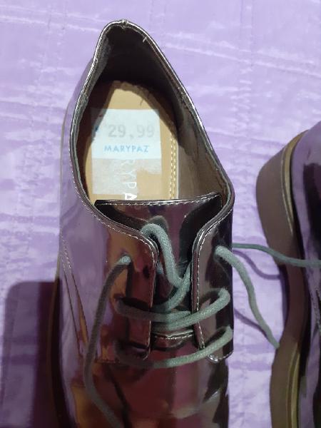 Dos pares zapatos plateados , muy buen estado ,poc