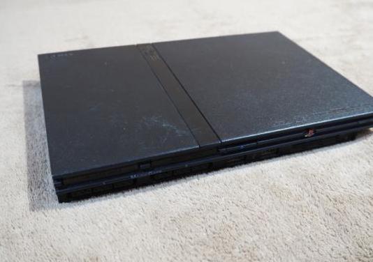 Playstation 2 con juegos y volante