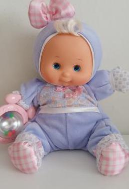 Juguete muñeca sonajero antigua