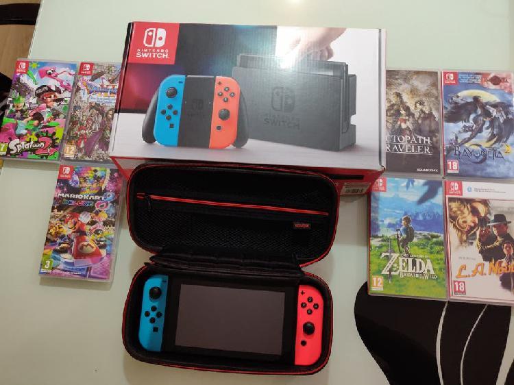Nintendo switch + 7 juegos + tarjeta sd + funda