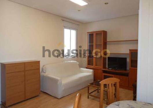 Conjunto salón, habitación y cocina