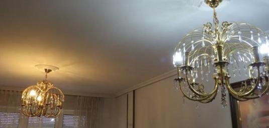 Dos lamparas iguales de ocho puntos de luz