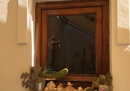 Puertas de ventanas y balcones de madera