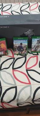 Xbox one x con juegos y un cargagor de bateria