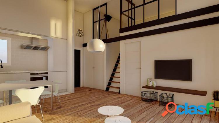 Apartamento tipo loft con gran altura de techos