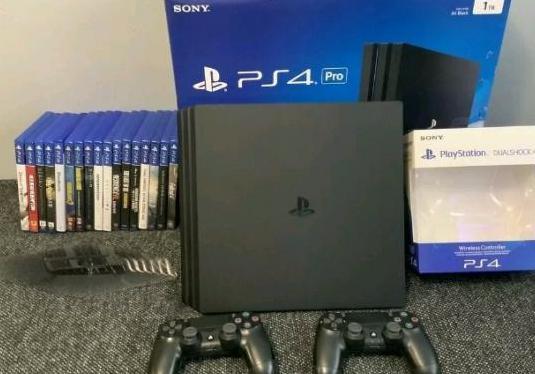 Consola ps4 pro nueva con juegos en caja