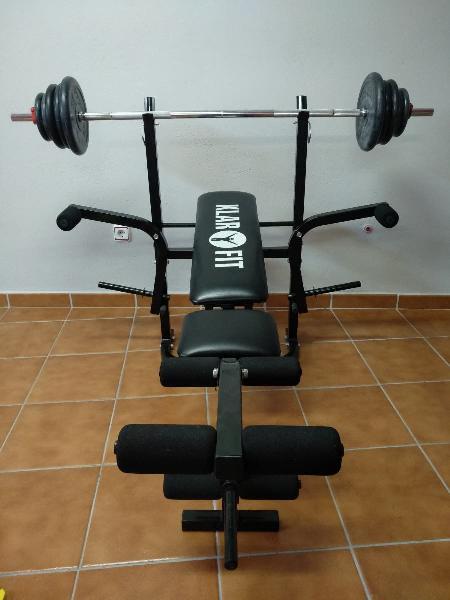 Banco de musculación con barra y pesas de caucho
