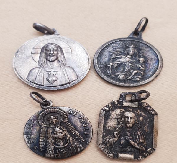 Lote de 4 medallas de plata de ley. religiosas. grabadas a