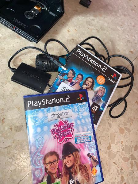 Play station 2 + dos juegos con sus complementos