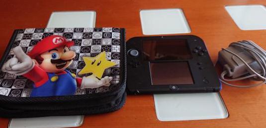 Nintendo 2 ds con funda juegos