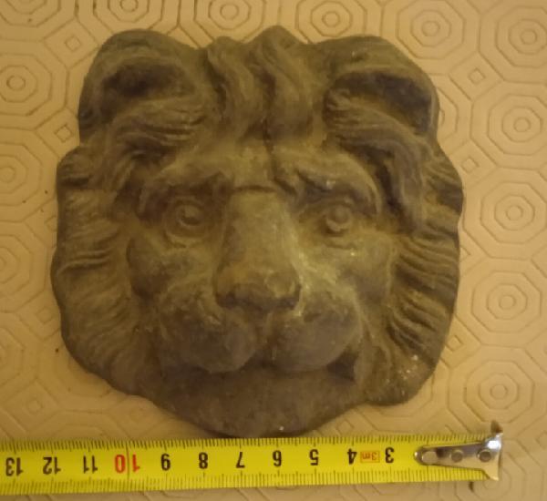 Animal de bronce antiguo cara de leon