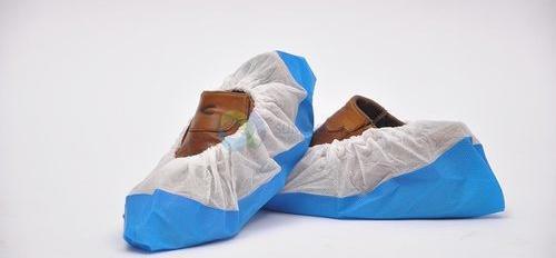 Cubrezapatos con suela cpe blanco/azul, caja 100 unidades