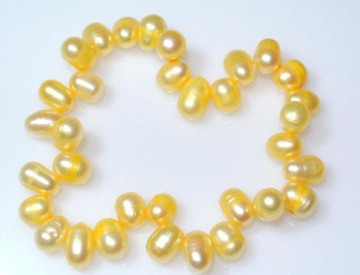 Pulsera de perlas naturales color amarillo, elastica, nueva