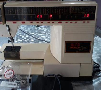 Maquina de coser alfa world(leer anuncio)