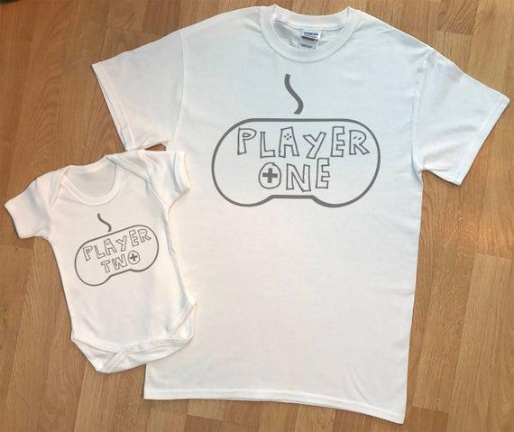Jugador one player two gamer - juego de padre y bebé a