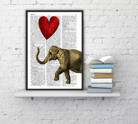 Christmas gift elephant with a heart shaped balloon on