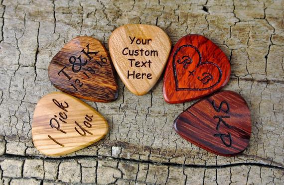 One custom wood guitar pick - custom engraved wooden guitar
