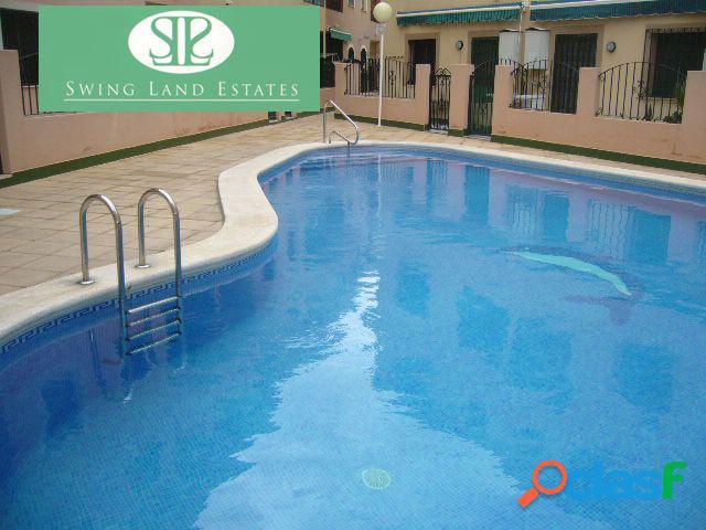 Bungalow planta baja con piscina comunitaria