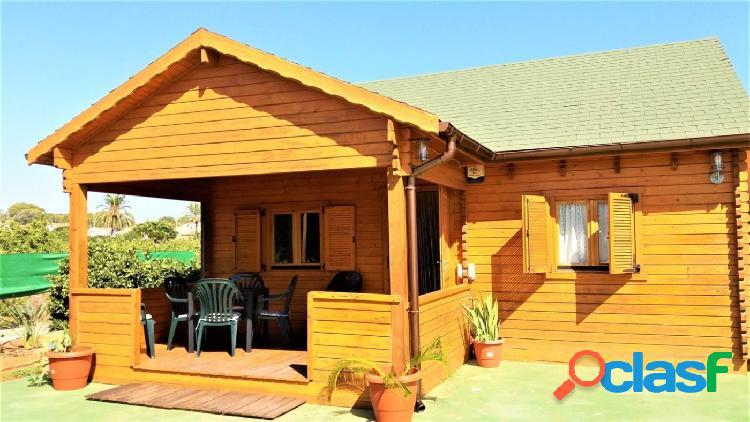Casa de madera de 61 metros cuadrados con parcela de 3823 metros cuadrados