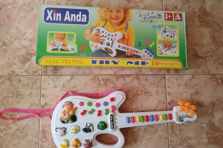 1 juego de guitarra electrica xin anda