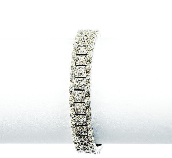 Pulsera en oro blanco, articulada, con 99 diamantes