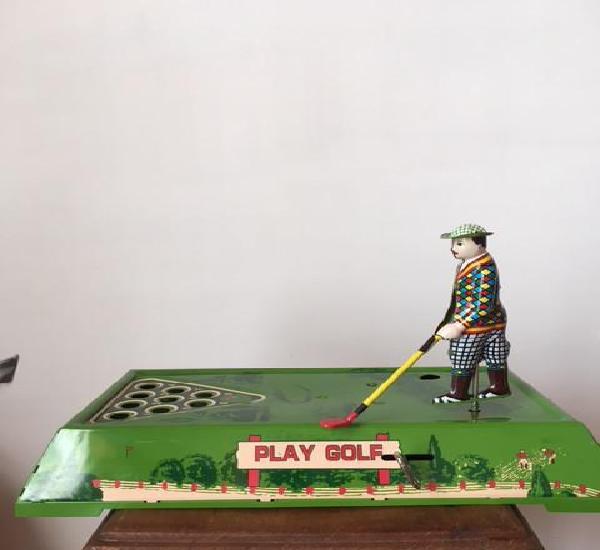 Jugador de golf a cuerda años 80