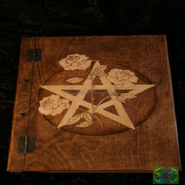 Wooden handmade book of shadows with pentagram and roses,