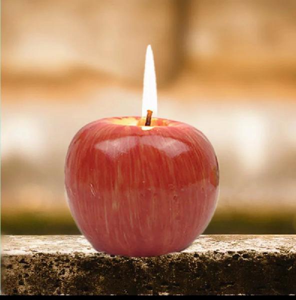 Vela perfumada en forma de manzana roja