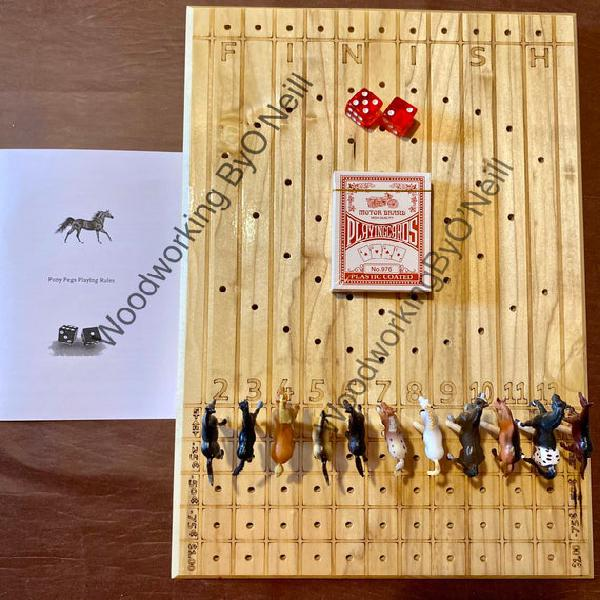 Carreras de caballos. juego de dados. pony pegs.