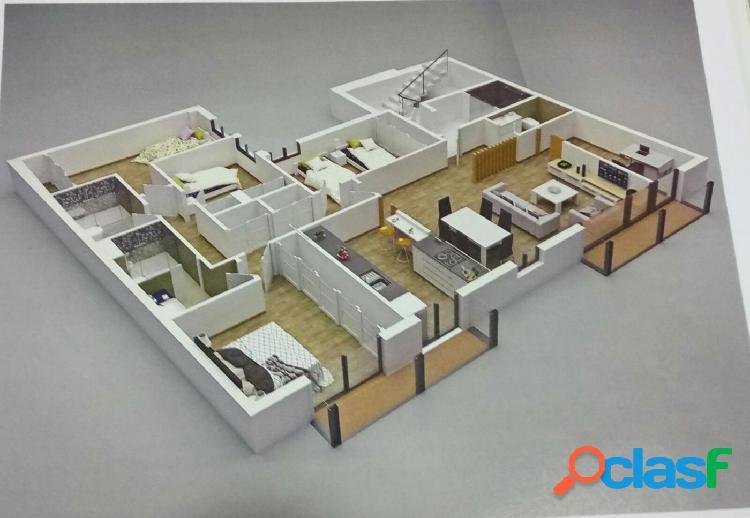 Próxima obra nueva junto a pisos azules