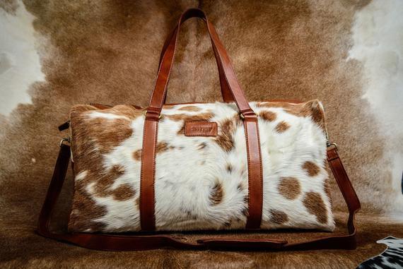 Marrón y blanco cuero duffel bolso grande cowhide bolsa de